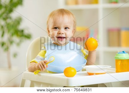 happy baby kid boy eating healthy food