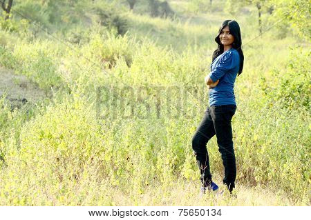 Portrait of teenage girl standing in outdoors