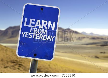 Learn From Yesterday sign with a desert background