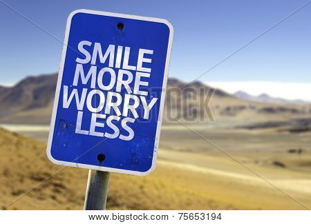 Smile More Worry Less sign with a desert background