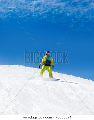 Snowboarder sliding down hill, snow snowboarding