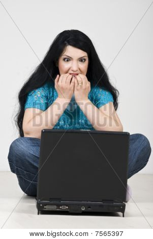 Stressed Woman With Laptop Bite Her Nails