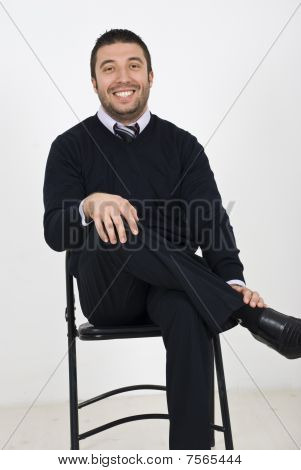 Laughing Businessman On Chair