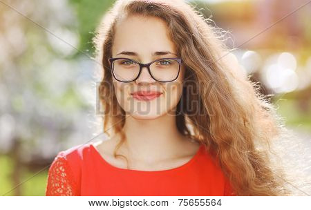 Charming Smiling Woman In Glasses