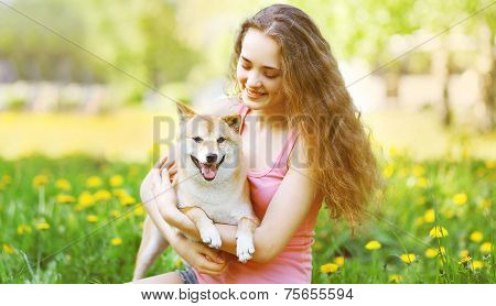 Happy Girl And Dog In Summer Sunny Park