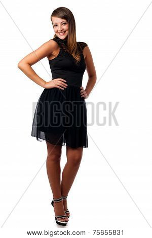 A Stylish Young Brunette Woman In Black Dress In Little Black Dress With Black Accessories