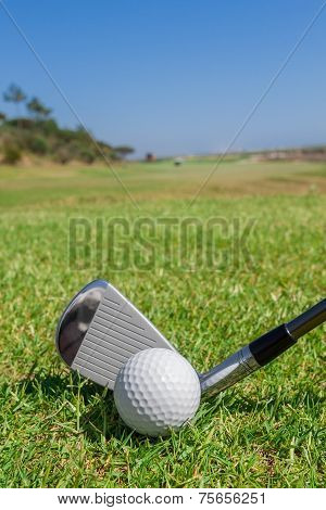 Putters And Ball On Green Field. Close-up.