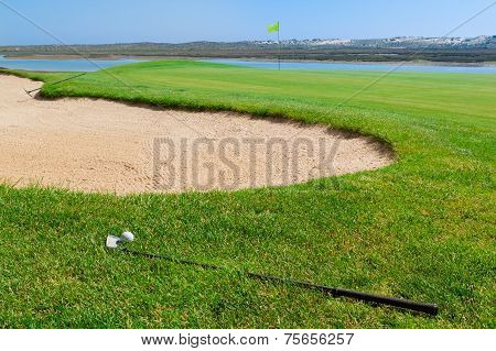 Putters And Ball Lying On Golf Course.