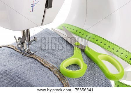 Dressmaker Scissors, Sewing Machine And Meter. Textile Close-up.