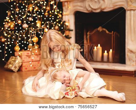 Christmas, Celebration, Holiday, Xmas Concept -  Little Girl Gives A Gift To His Sleeping Sister