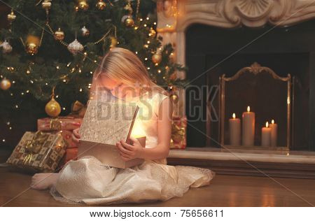 Christmas, Magic, People Concept - Happy Child Opens The Magic Box With A Gift