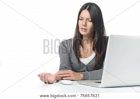 Young Businesswoman Rubbing Her Wrist