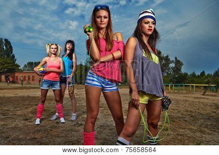 Young happy sport women working out