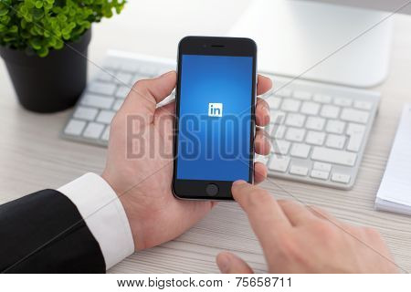 Businessman Holding Iphone 6 Space Gray With Service Linkedin