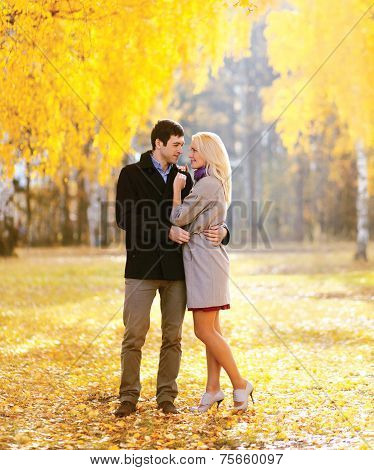 Autumn, Love, Relationships And People Concept - Lovely Couple In Love Outdoors In Sunny Autumn Park