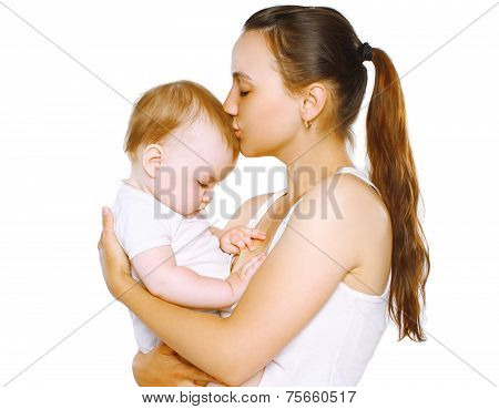 Sensual Mom Kiss Baby On A White Background