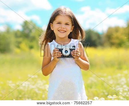 Happy Smiling Child With Retro Vintage Camera Having Fun Outdoors In Sunny Day