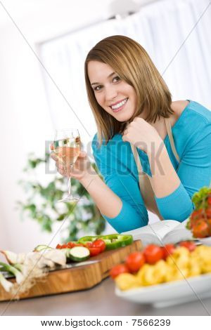Cooking - Smiling Woman With Glass Of White Wine