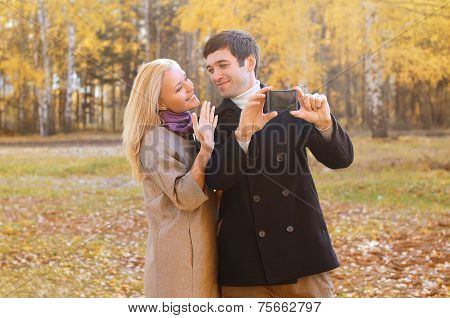 Love, Relationship, Technology And People Concept  - Happy Smiling Couple In Love Making Selfie Outd