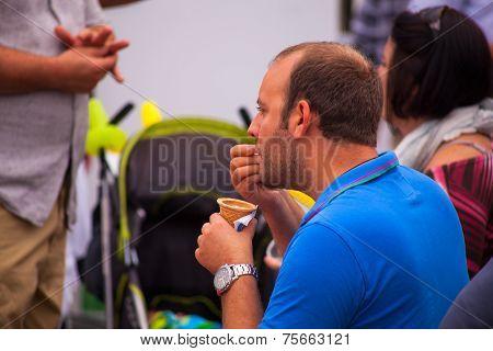 Man Tasting Ice Cream