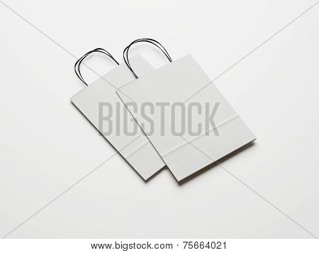 Two Blank Paper Bags With Black Handles