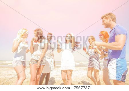 Friends Drinking And Having Fun On The Beach