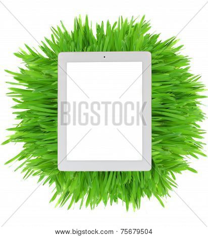 tablet  on fresh green grass