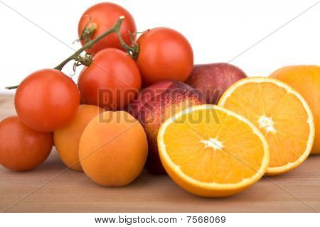 Orange, Tomatoes, peach and plums