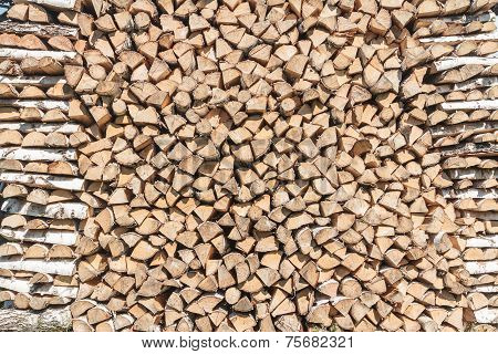 Stack Of Split Birch Firewood During Drying
