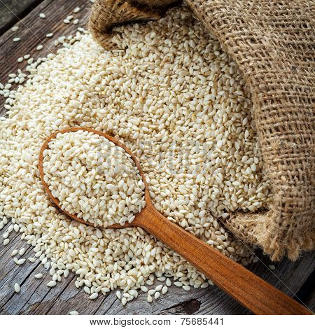 Sesame Seeds In Wooden Spoon On Wooden Rustic Table
