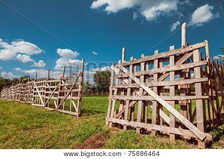 Wooden Rustic Fence, Blue Sky And Village Landscape
