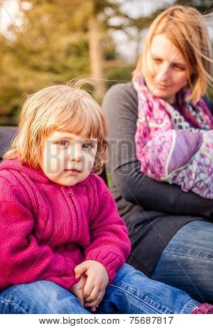Mother and daughter on the parkbench
