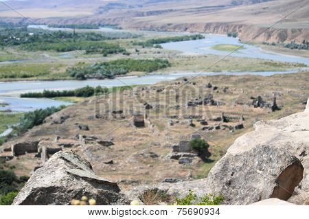 ruins and bend of river, view from cave ancient pagan city Uplistsikhe