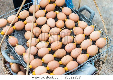 Grilled Egg On Stack Basket  As Street Food