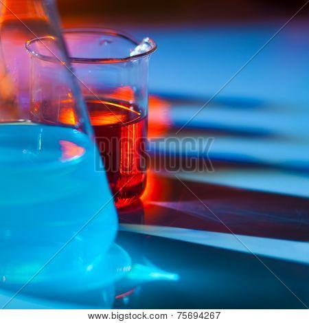 Backlit laboratory flask.