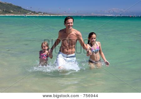 Young Father And His Two Daughters On Vacation