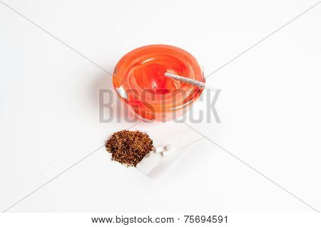 Tobacco Kit And Red Ashtray