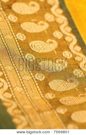 Closeup Of Golden Embroidery On Indian Saree.