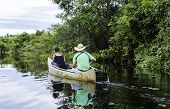 picture of canoe boat man  - Couple riding canoe in Pantanal River - JPG