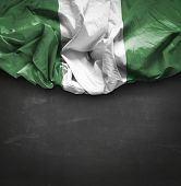 stock photo of nigeria  - Nigeria waving flag on blackboard - JPG