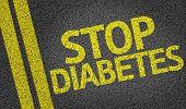 stock photo of diabetes symptoms  - Stop Diabetes written on the road - JPG