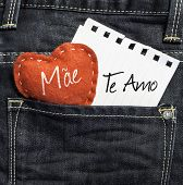 "foto of i love you mom  - ""Mae, Te amo"" (In portuguese - Love You, Mom) written on a peace of paper and a heart on a jeans background - JPG"