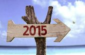 stock photo of reveillon  - 2015 wooden sign with a beach on background  - JPG