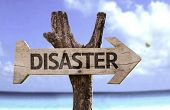 stock photo of cold-war  - Disaster wooden sign with a beach on background  - JPG