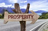 stock photo of prosperity sign  - Prosperity wooden sign with a street background  - JPG