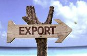picture of export  - Export wooden sign with a beach on background  - JPG