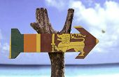 picture of sinhala  - Sri Lanka wooden sign with a beach on background  - JPG