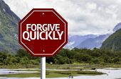 pic of forgiveness  - Forgive Quickly red sign with a landscape background - JPG