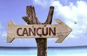 stock photo of gulf mexico  - Cancun wooden sign with a beach on background - JPG