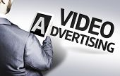 picture of televisor  - Business man with the text Video Advertising in a concept image - JPG